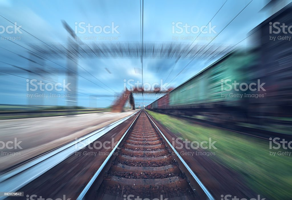 Railway station with cargo wagons in motion blur effect stock photo
