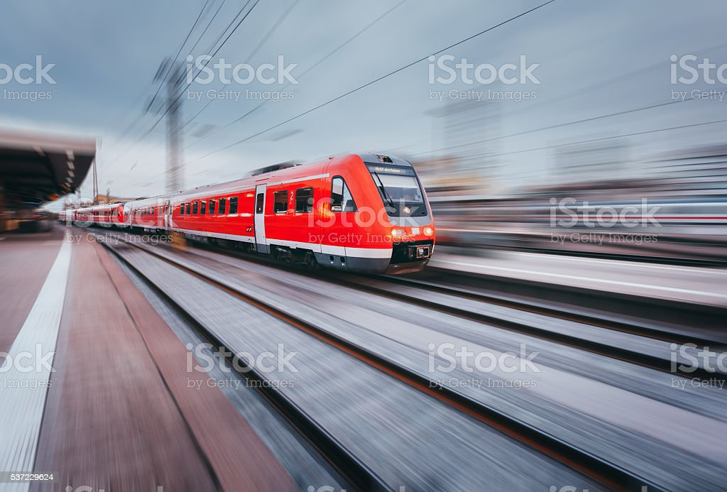 Railway station with modern red passenger train. Industrial landscape stock photo