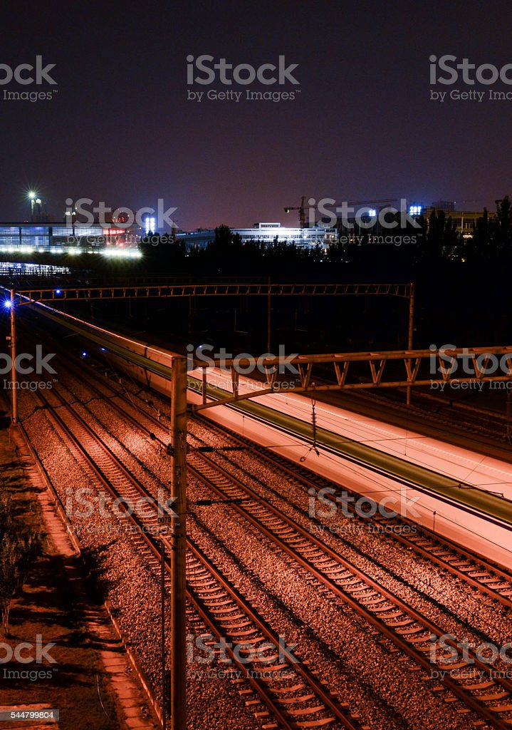 Railway station with motion train at night stock photo