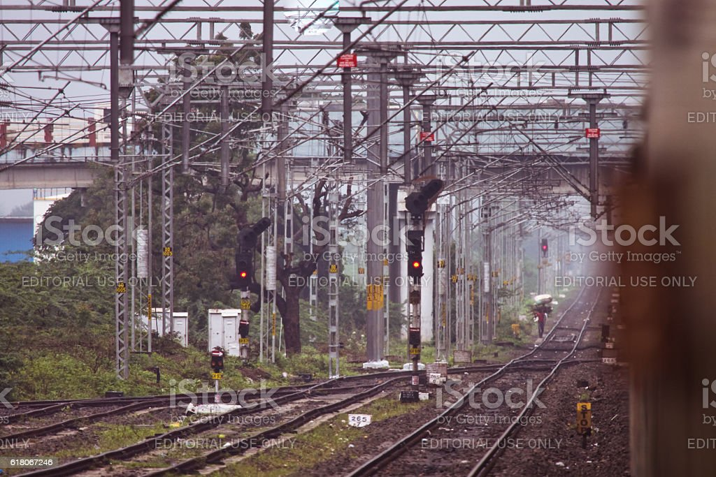 Railway track and man carrying load on his head stock photo