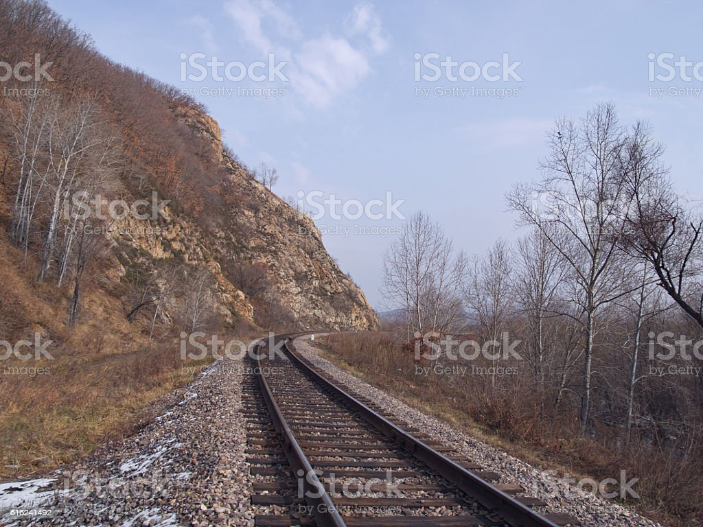 Railway track at a mountain slope stock photo
