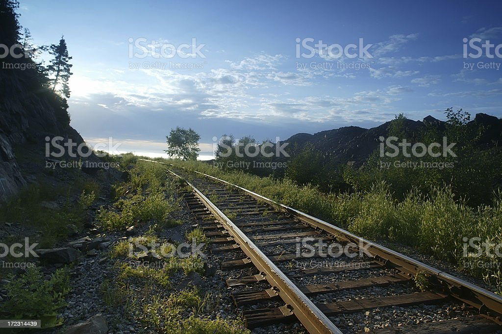 Railway track by the field in Baie St-Paul royalty-free stock photo