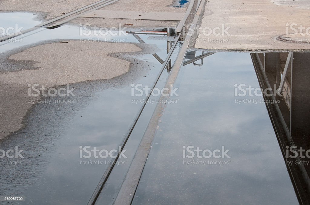 Railway track on a puddle, stock photo
