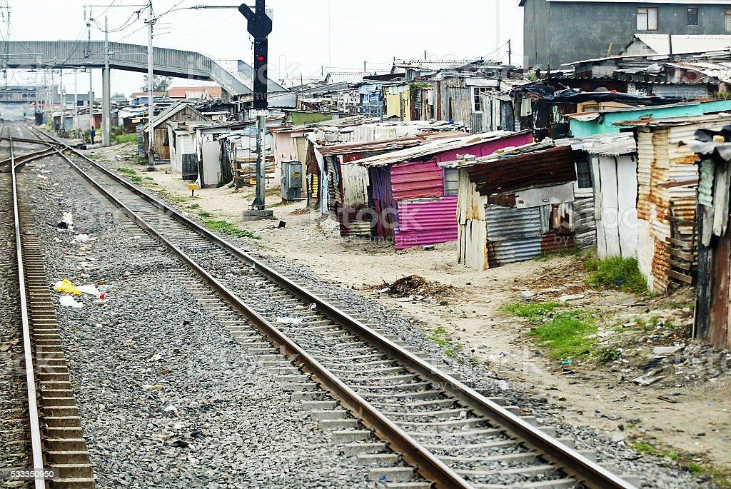 Railway track through shacks in ghetto stock photo