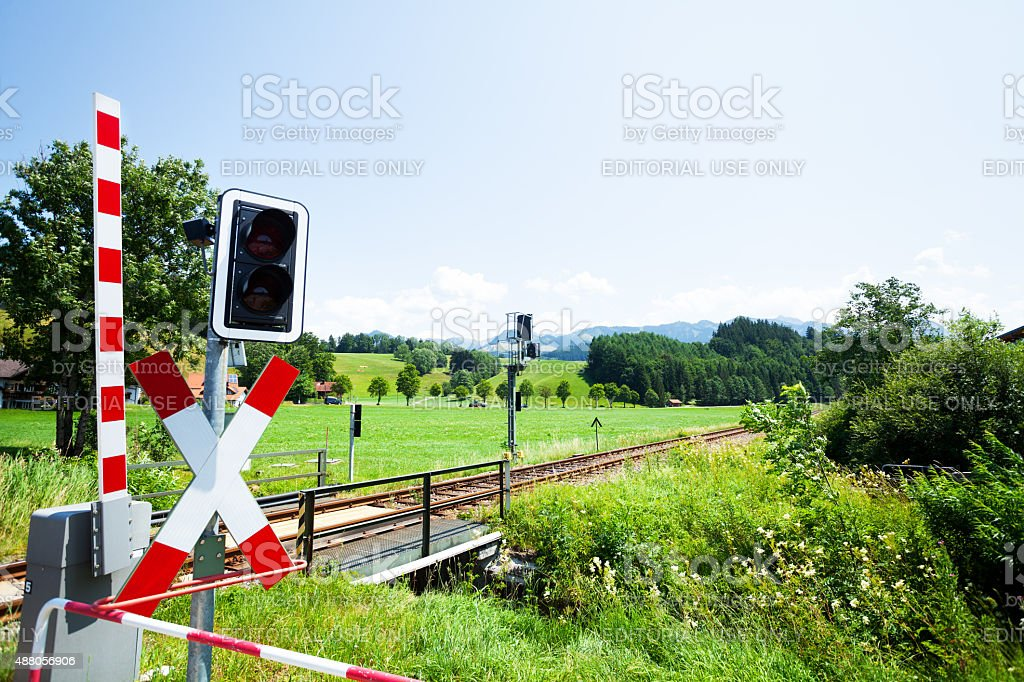 Railway tracks and crossing in Sonthofen stock photo