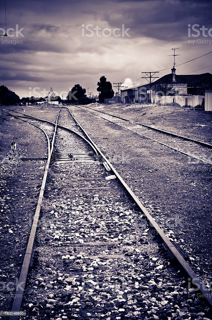 Railway tracks deserted and post apocalyptic royalty-free stock photo