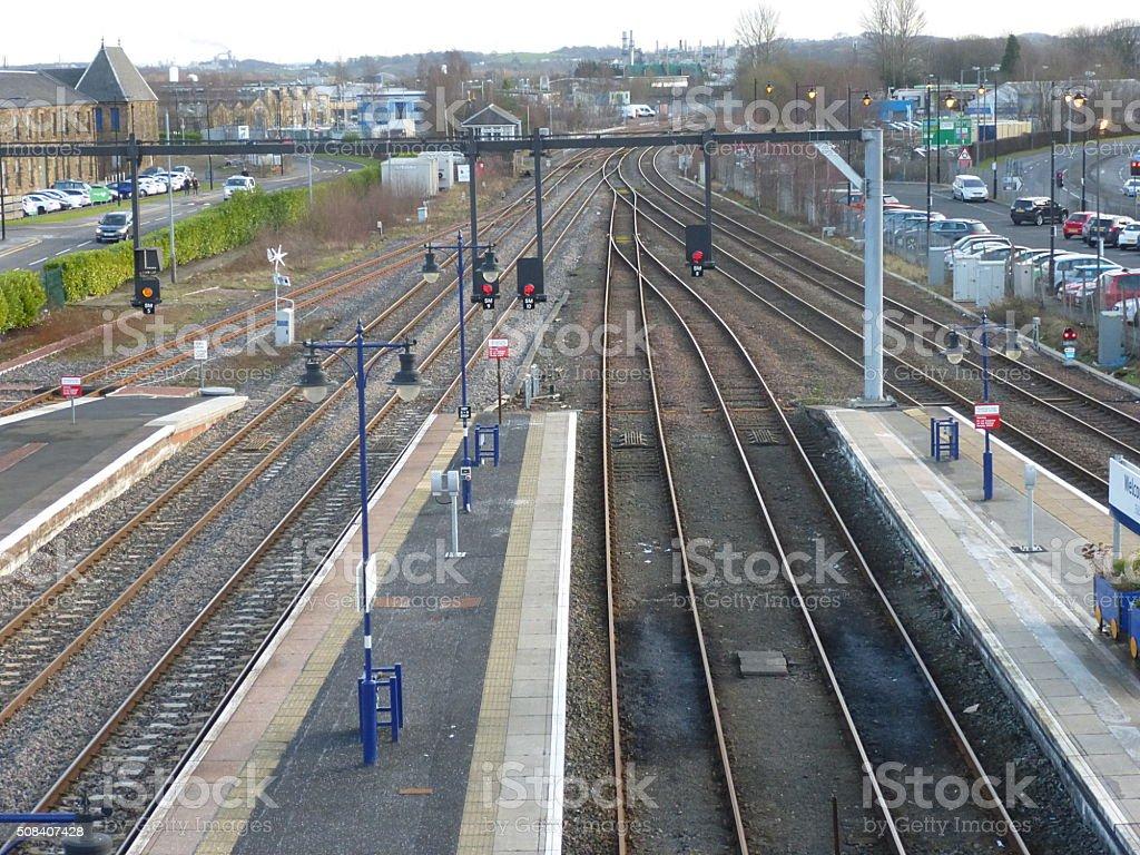 Railway tracks leaving station stock photo