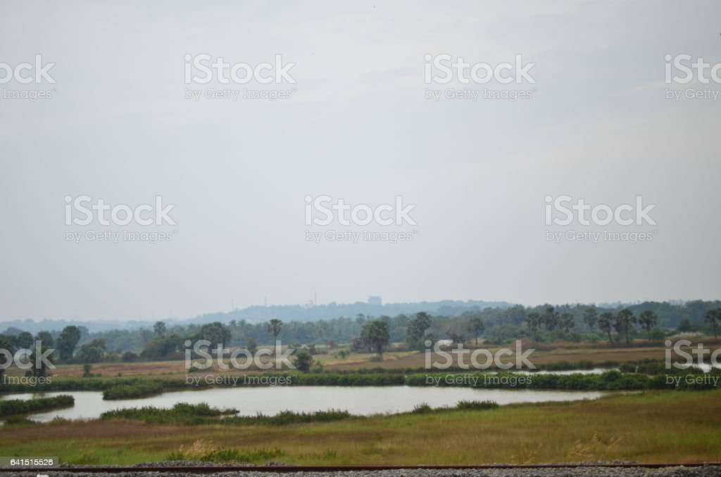 Railway Tracks passing through a rural area stock photo