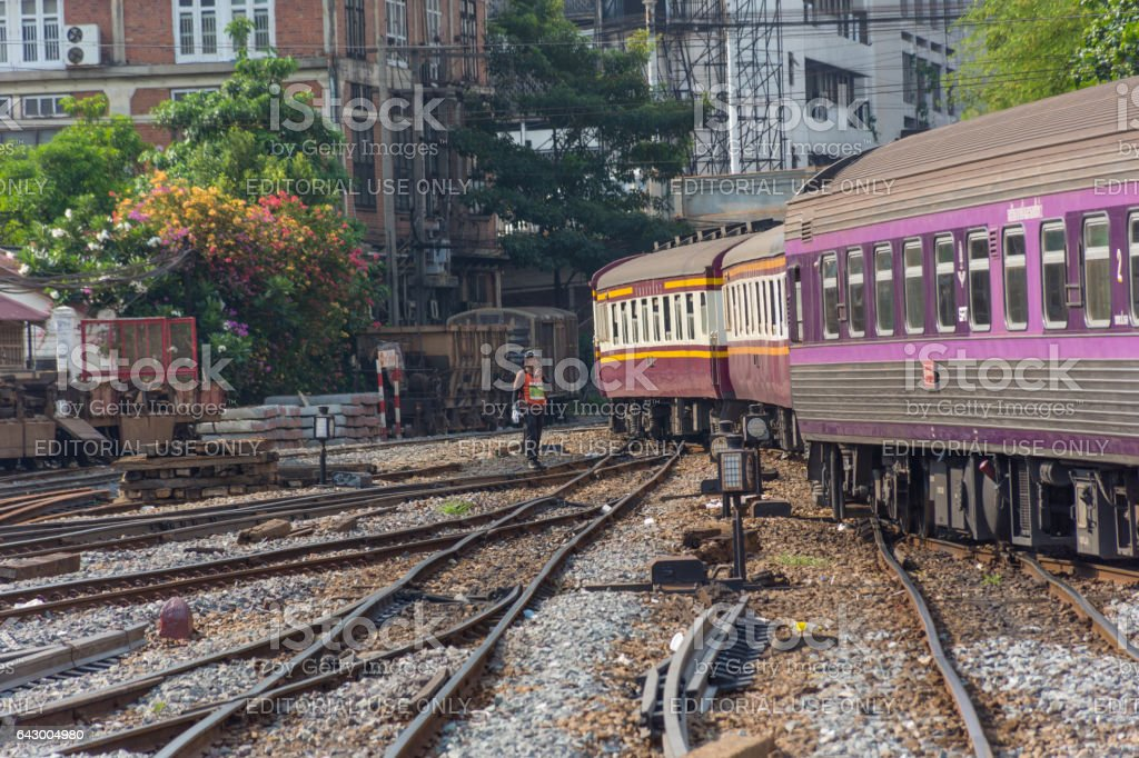 Railway train on the railroad tracks in Bangkok station stock photo
