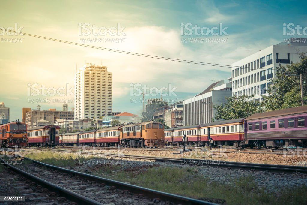 Railway train run on the railroad tracks. Many people in Thailand popular travel by train because it is cheaper. , process in vintage style stock photo