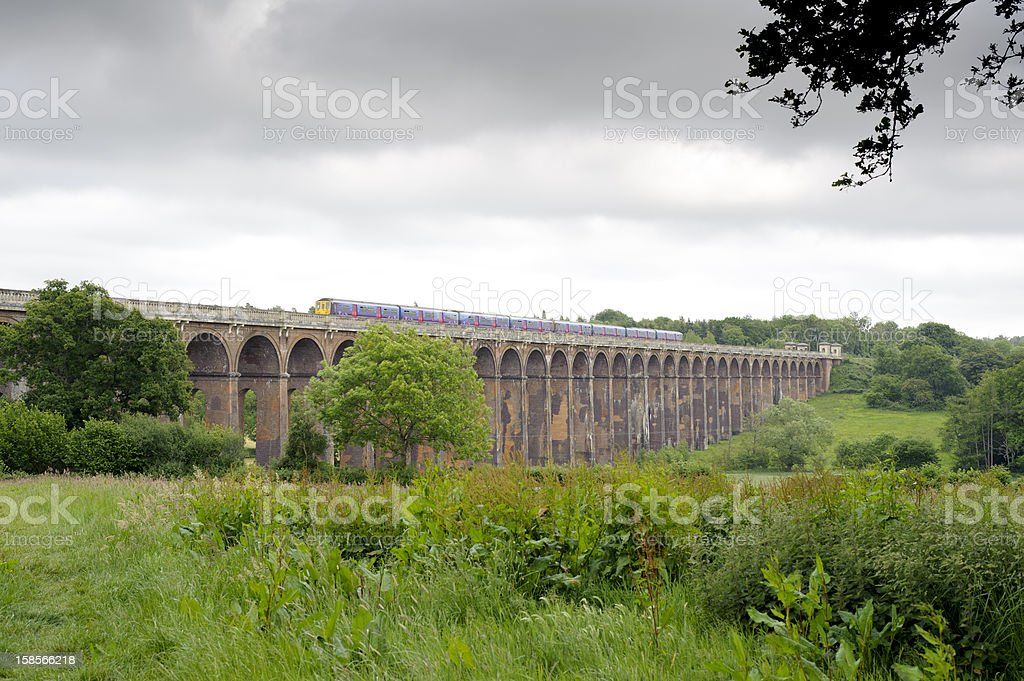 Railway viaduct with train royalty-free stock photo
