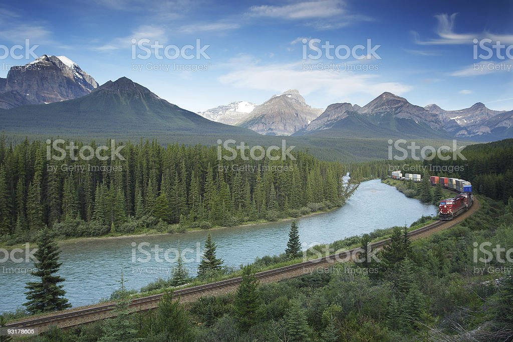 Railway with train in Banff National Park, Canadian Rockies stock photo