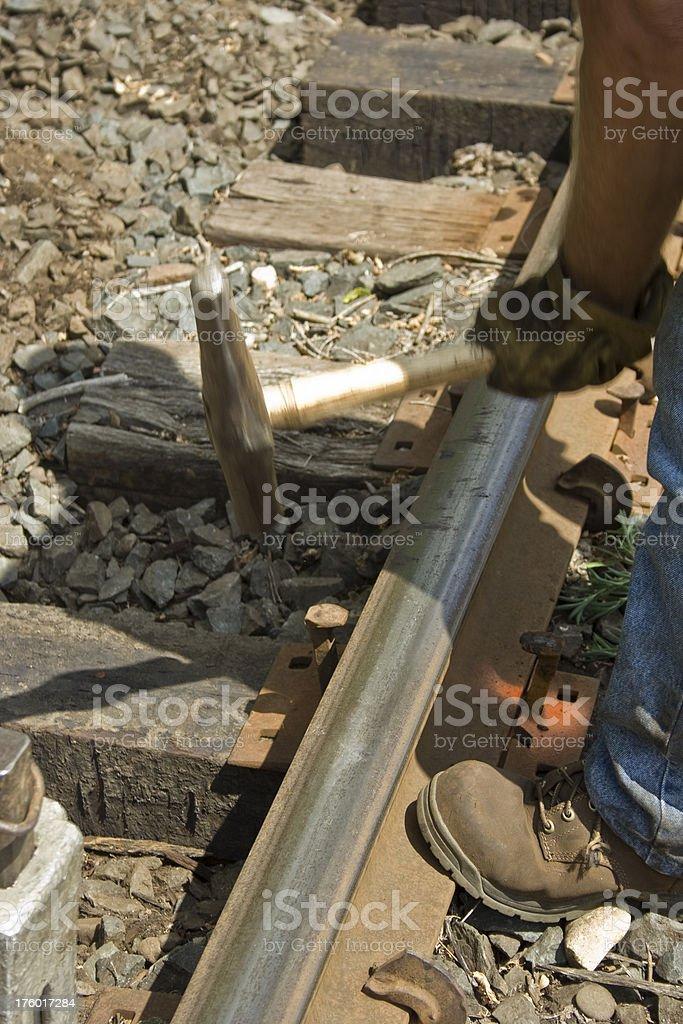 Railway Worker Pounding Spikes stock photo