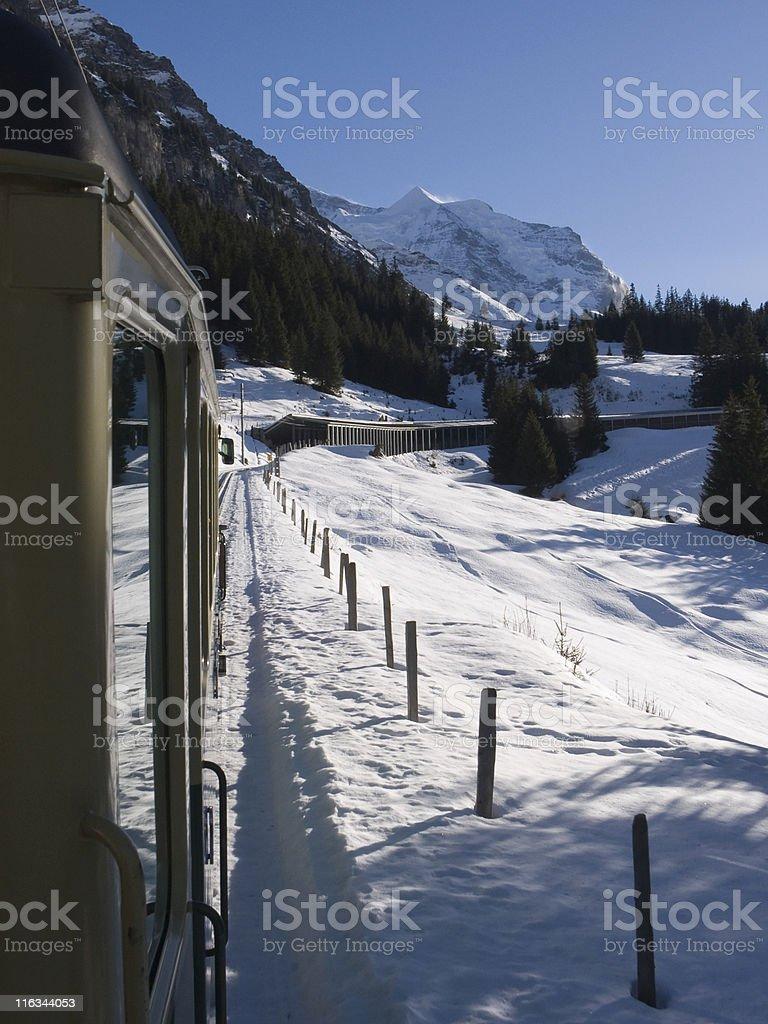 Railways; Tourist train in winter landscape, Kleine Scheidegg, Switzerland royalty-free stock photo