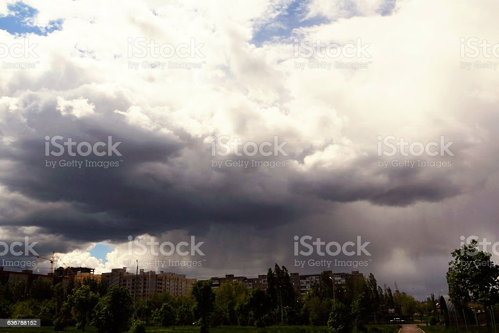 Rain and a thunderstorm looming over the city in the evening. stock photo