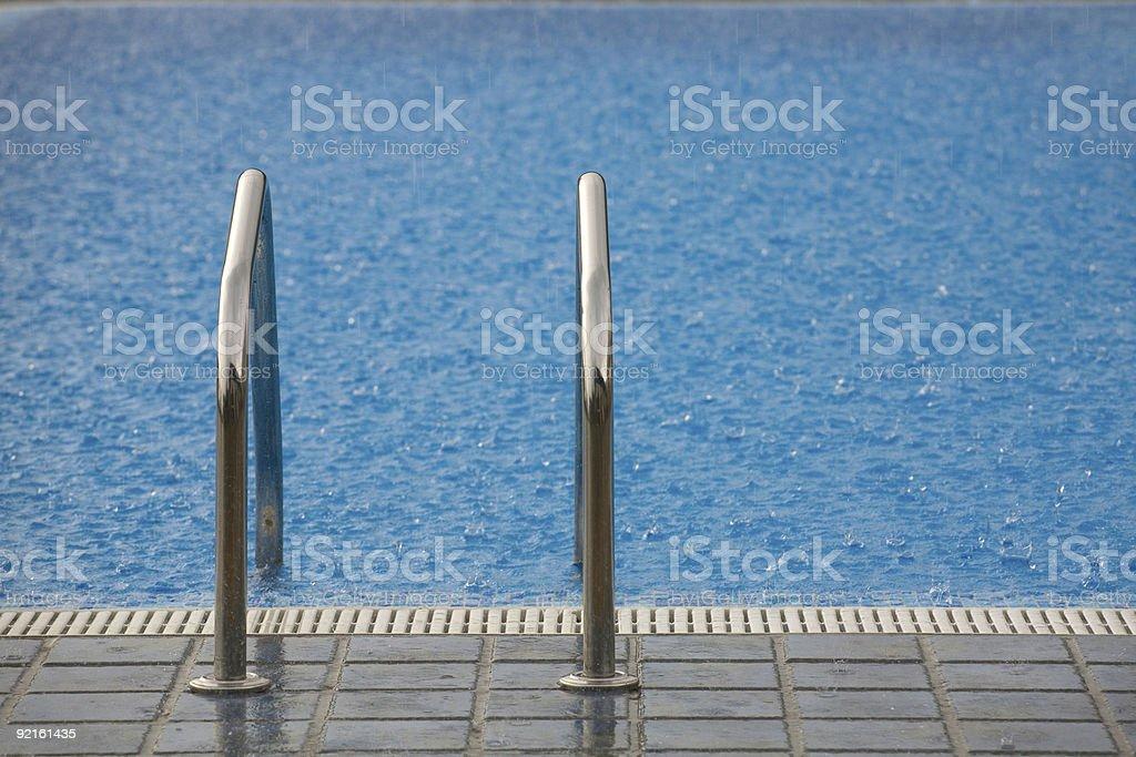 Rain and empty swimming pool stock photo