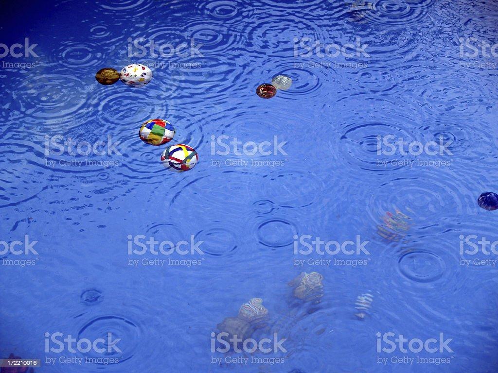 Rain, balls & pool. royalty-free stock photo