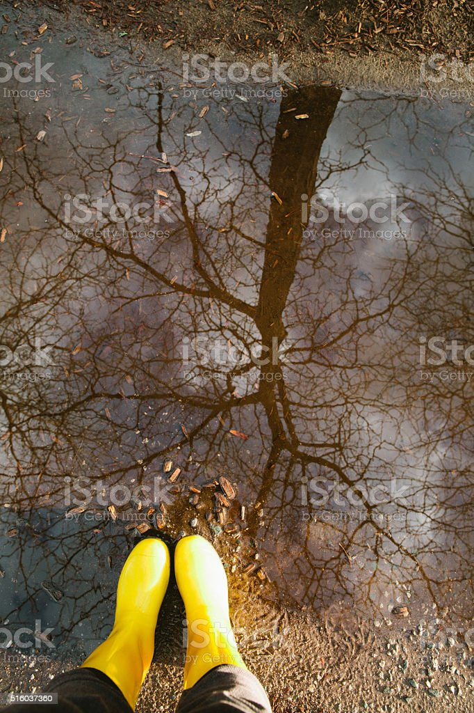 Rain boots and puddles stock photo