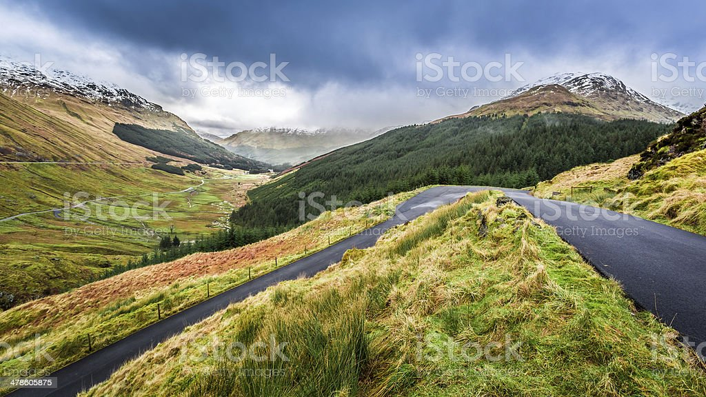 Rain clouds over a mountain valley stock photo