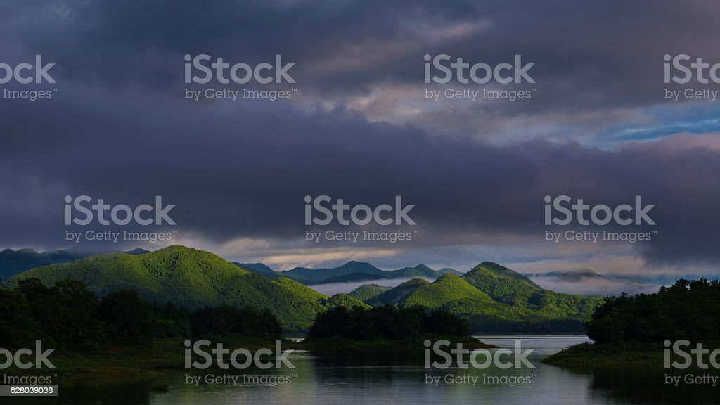 Rain clouds over the lake in the morning. stock photo