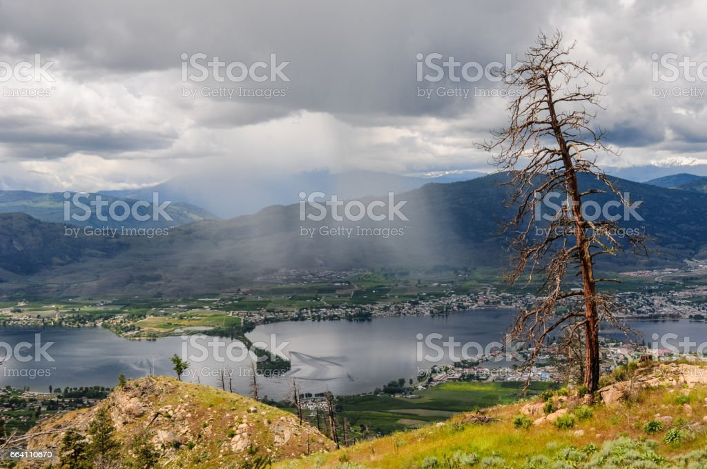 Rain clouds rolling over the town and lake Osoyoos, Southern British Columbia, Canada. stock photo