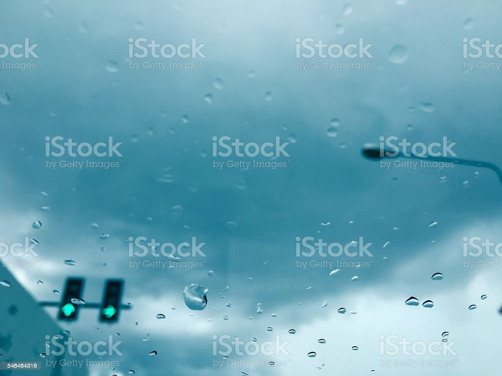 rain cover the window with blur green light traffic light royalty-free stock photo