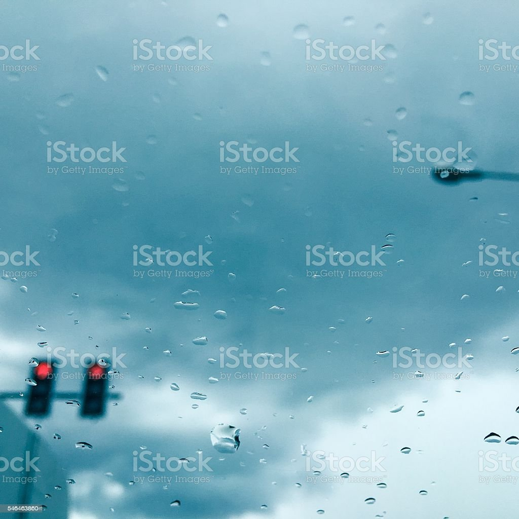 rain cover the window with blur red light traffic light royalty-free stock photo