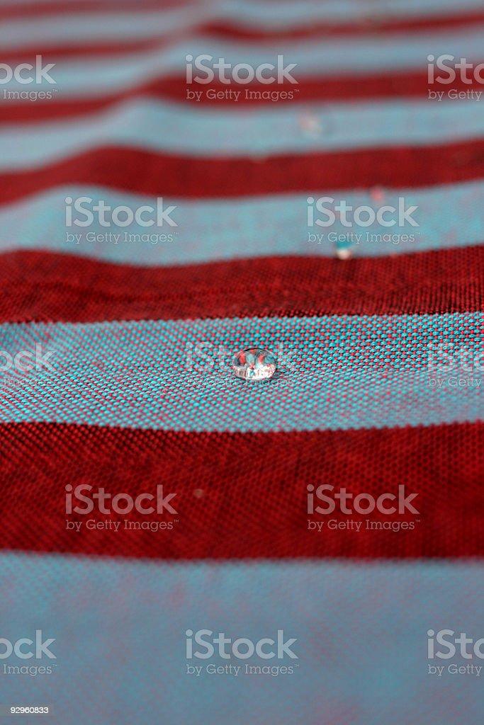 Rain drop on a flag royalty-free stock photo