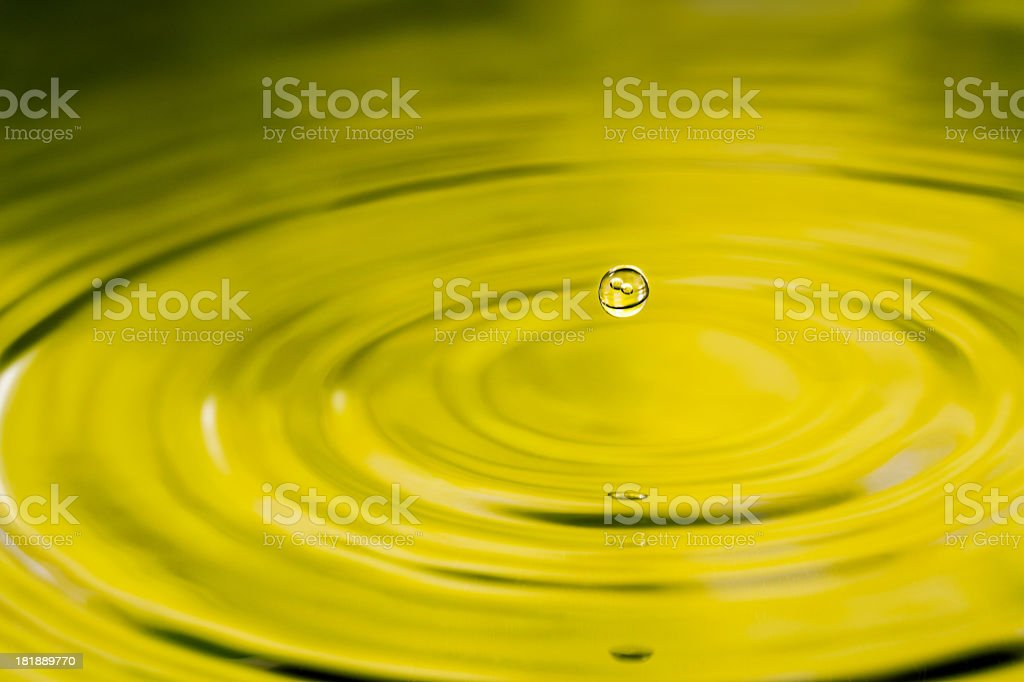 Rain drop with two bubbles in it stock photo