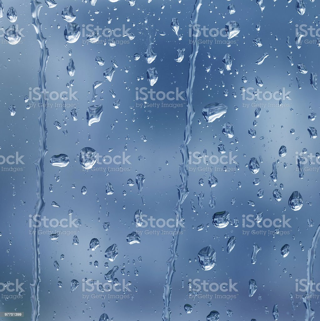 Rain drops on a glass wall with blurry background royalty-free stock photo