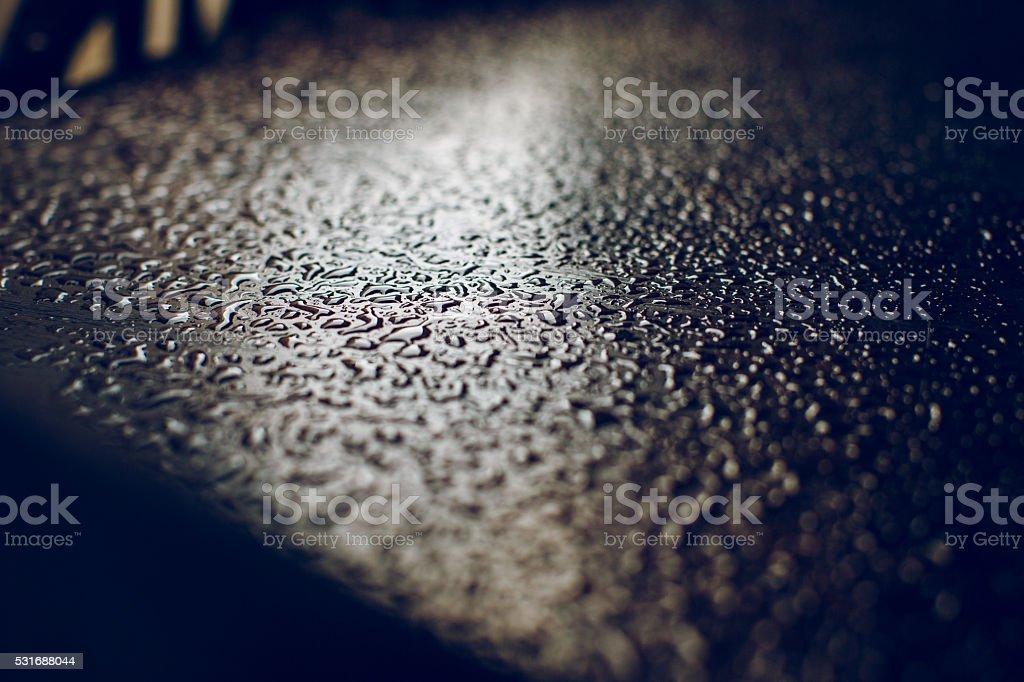 Rain drops on a table stock photo