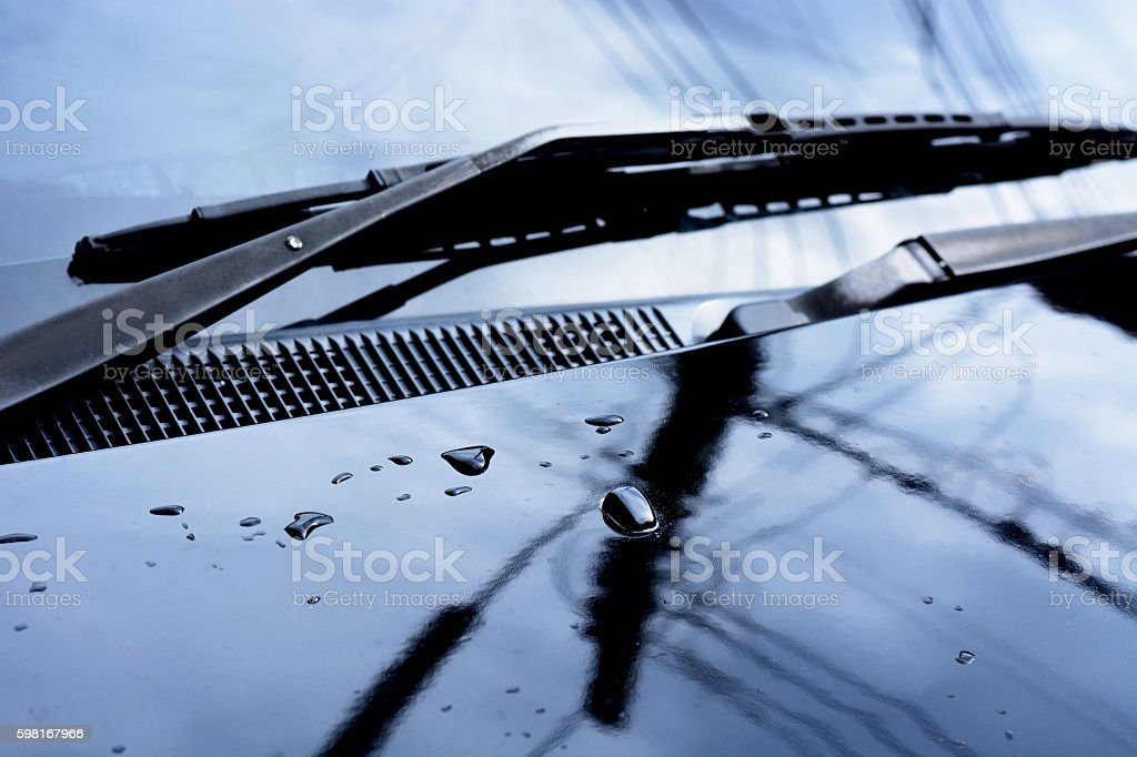 rain drops on car glass in rainy days. stock photo