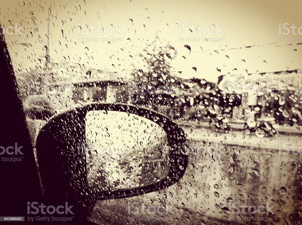 rain drops on the car window grass. Picture in vintage style. stock photo