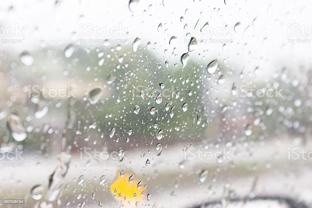 Rain drops on the other side of the glass. stock photo