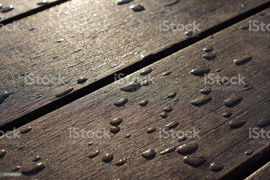 Rain drops on wood stock photo