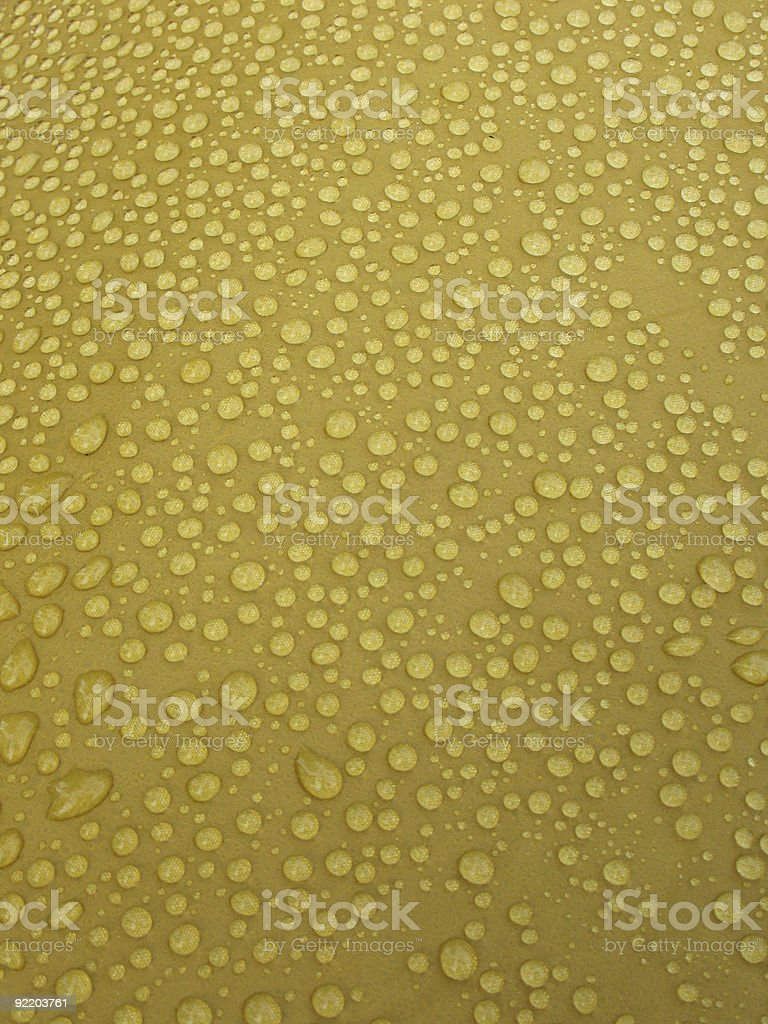 Rain drops on yellow surface. royalty-free stock photo