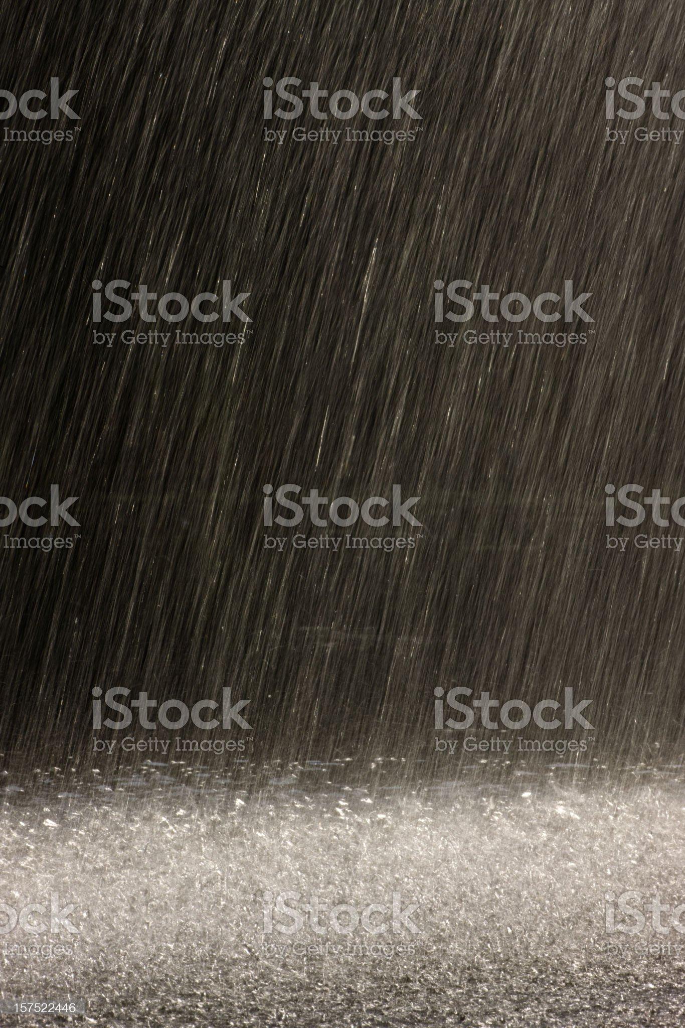 Rain falling backlit by sunshine. royalty-free stock photo
