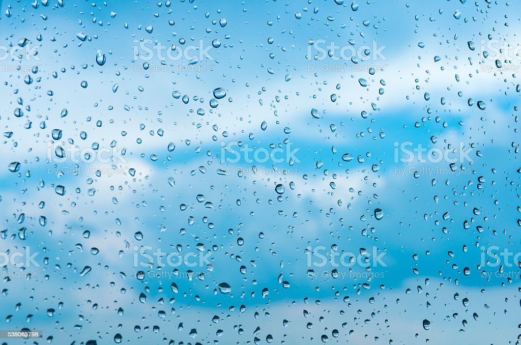 Rain Falling Raindrops Window White Cloud Blue Sky Rainy stock photo