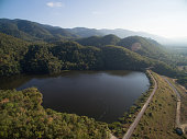 Rain forest and reservoir in top view