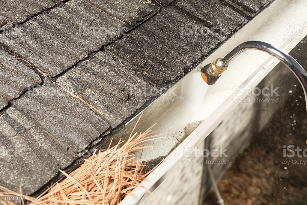 Rain Gutter Cleaning with Pressure Washer stock photo