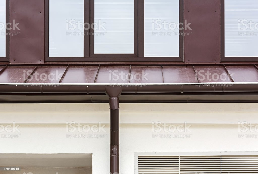 Rain gutter on a home royalty-free stock photo