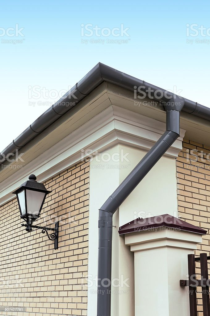 Rain gutter with drainpipe stock photo