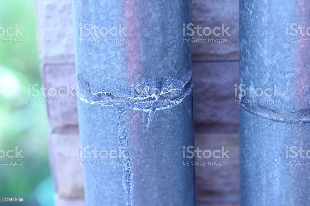 Rain gutters are attached to the roof and exterior walls stock photo