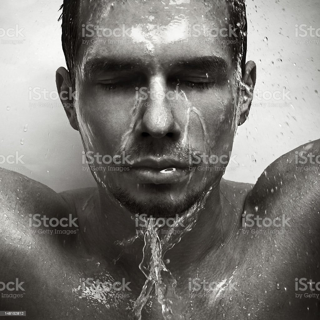 Black and white self-portrait of a man in the rain.