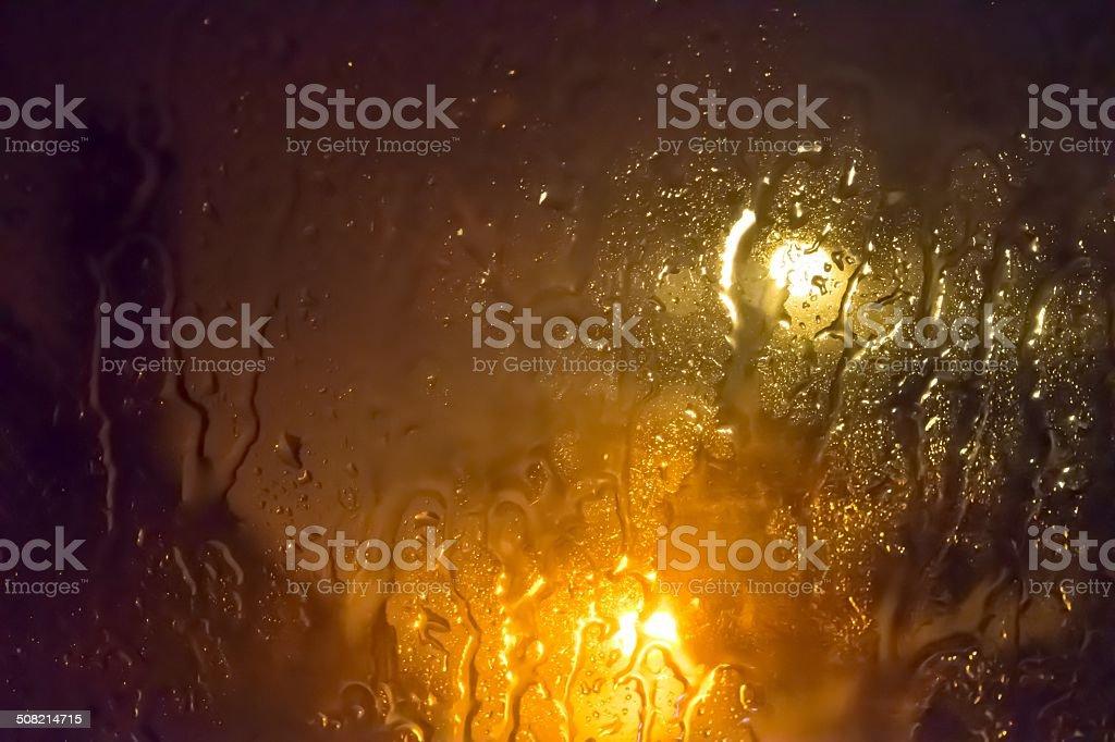 Rain on Glass at Night stock photo
