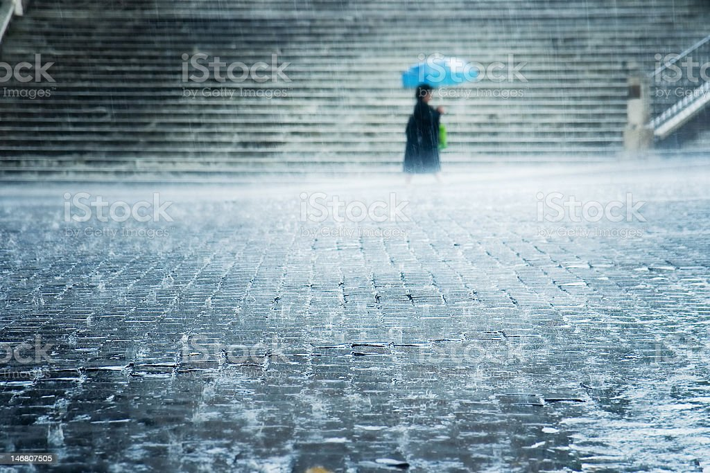 rain on street floor with lady under umbrella  and stairs royalty-free stock photo