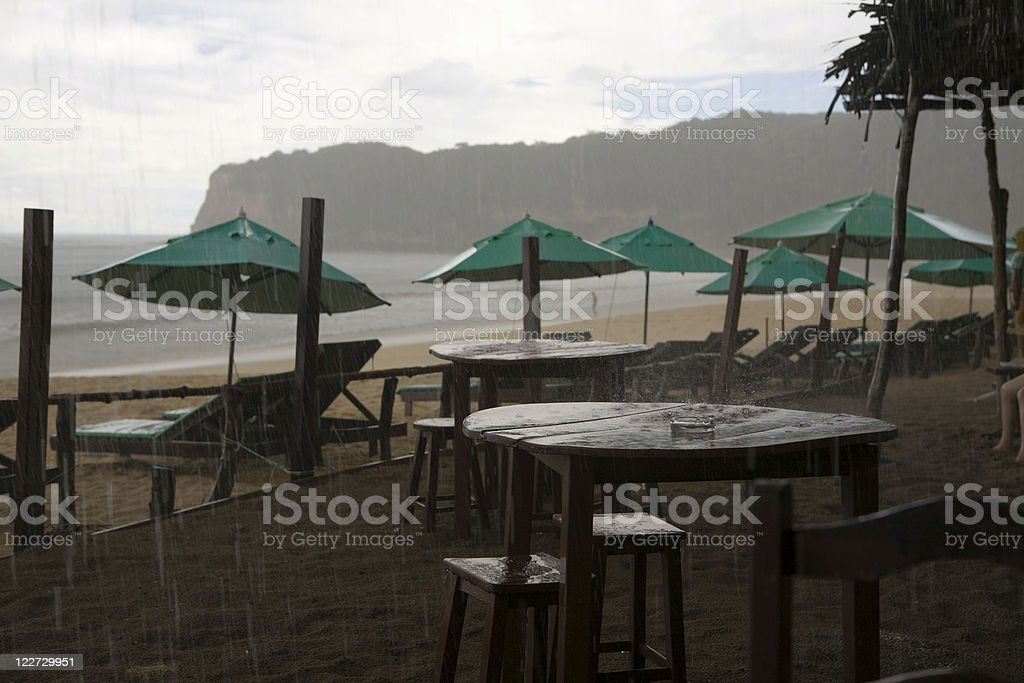 Rain on the beach stock photo