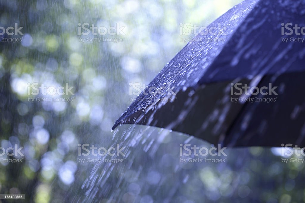 Rain on umbrella stock photo