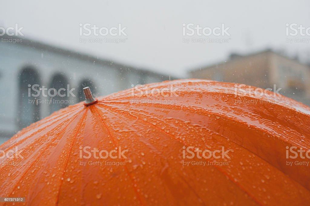 Rain on umbrella stock photo