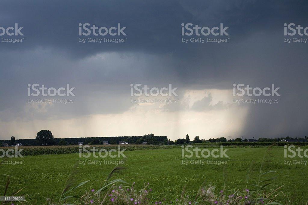 Rain pouring down on small village royalty-free stock photo